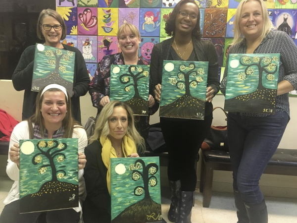 Image of women enjoying paint and sip party at Bright Zebra Art Studio in Morganville NJ