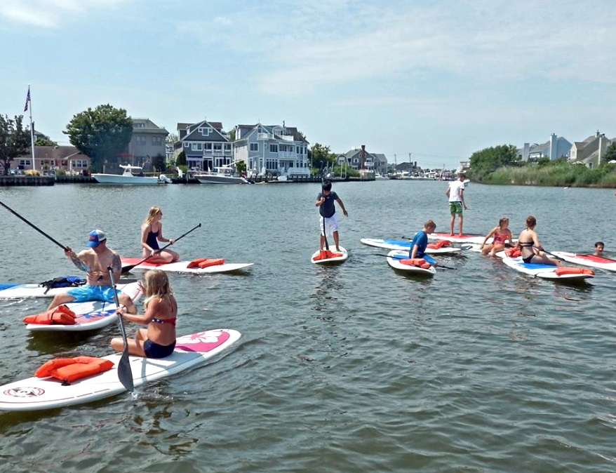 Image of people on paddleboards during a paddleboarding class with Paddleworks at the Jersey Shore NJ