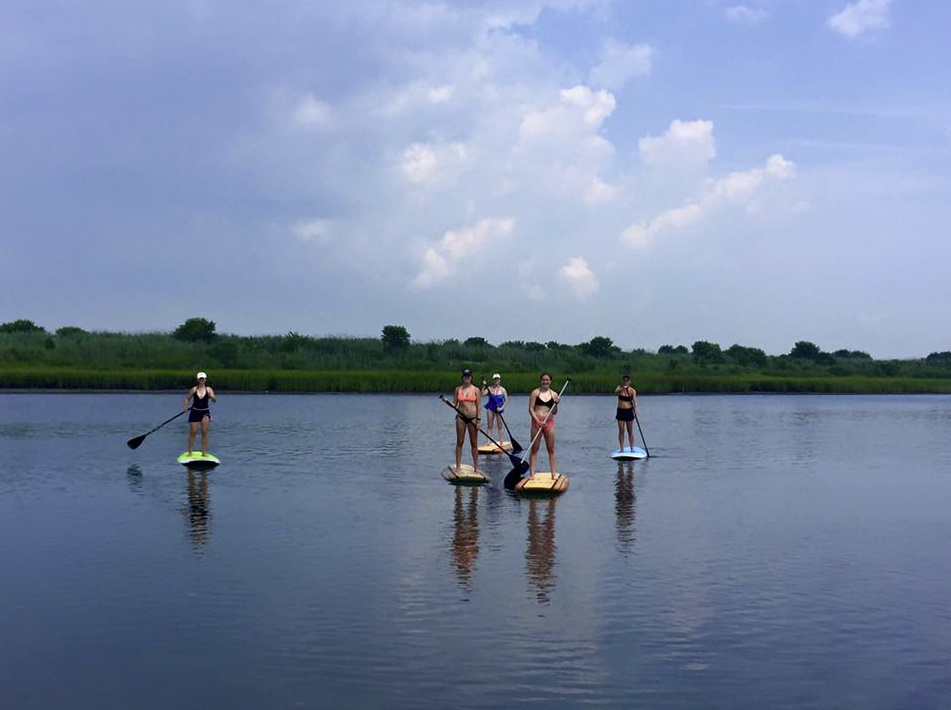 Image of 5 people on paddleboards with SUP Guy Paddle Board Rentals in Cape May NJ