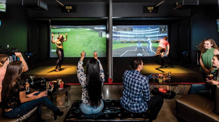 Image of people playing games at iPlay Americas all-new Topolf Swing Suite in Freehold NJ