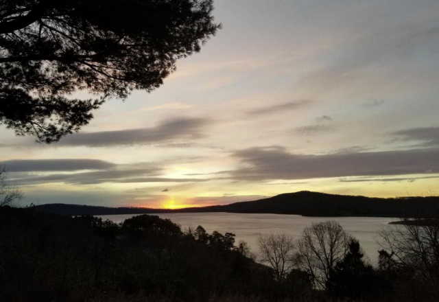 Photo of the sun setting over Round Valley Reservoir